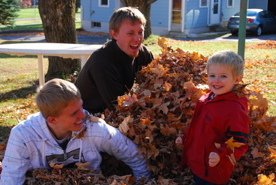 Ryan and Jason playing in the leaves with our nephew Kellon