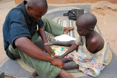 Etienne working with one of the children