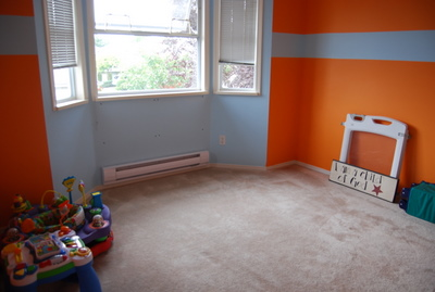 Here's the room that will become the baby's room! It's a nice shade of hurt-your-eyes orange right now.